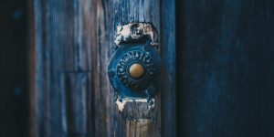 Ring the doorbell and leave a present on someone's doorstep