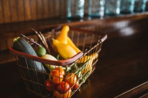 Help someone with their grocery bags