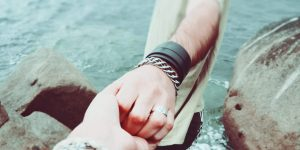 a woman and a man hand holding